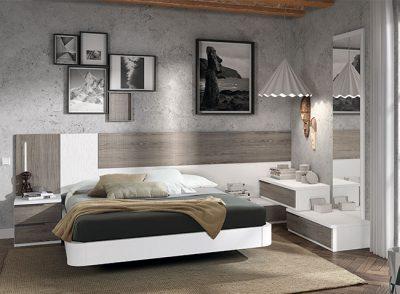 Dormitorio matrimonio asimétrico con cama flotante y cabecero con mesitas en blanco lacado y madera