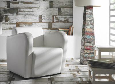 Sillón bajo de estilo moderno tapizado en polipiel