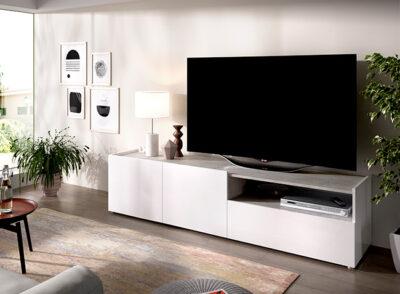 Mueble TV gris cemento con dos puertas y hueco para dispositivos electrónicos